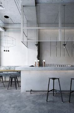 hikki restaurant bar in osaka concrete countertop and metal cage
