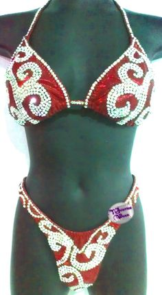 2 PC Figure / Physique competition suit. Red Crest shines on stage. Top and bottom straps stoned $875.