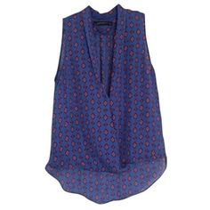 Zara southwestern print blue sleeveless top This Zara Woman sleeveless top has a high-low design and has a deep plunge v neck as well. It is a blue-purple color with red and light blue southwestern print. Gently worn. 100% polyester, made in Morocco. Zara Tops Tank Tops