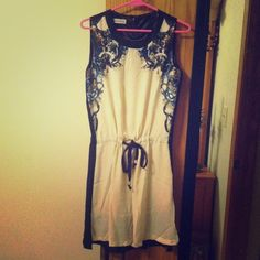 """HOST PICK 1-25-15Cream/black dress sz M HOST PICK 1/25/15 by @kywongrowski for her Necessary Neutrals Party!! Soo very excited & honored that my new pal picked this cutie!! Brand new dress w/ artsy cherub design @ sleeves. Fully lined & drawstring waist. Cream colored front, black back. Would fit a small or smaller med best. I'm a solid med. & it was not comfortable enough to keep.  5'4"""" & it hit a little above the knee. Ordered online. Seen elsewhere for $45. Never worn! Firm Price is what…"""