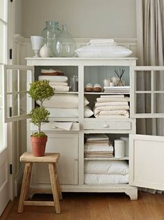 Use a vintage cabinet as a freestanding linen closet in the bathroom