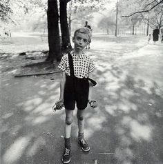 // Diane Arbus :: I enjoy the contrast and the raw look of the image. The black/white also adds to the appeal.