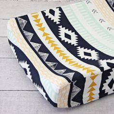 Wow! Love this print. Very gender neutral Aztec Gold and Mint Crib Changing Pad Cover