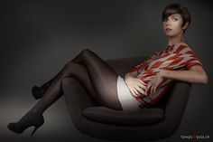 Girl with short hair posing in black pantyhose