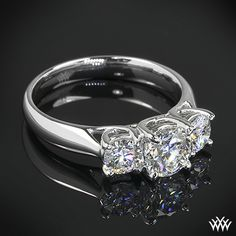 """This 3 Stone """"Trellis"""" Diamond Engagement Ring is set in platinum and has two 0.25ct A CUT ABOVE® Hearts and Arrows Diamond Melee flanking each side of the gorgeous 0.702ct center A CUT ABOVE® Diamond."""