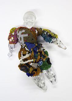 From the Ancestry/Progeny Series: Prayers, by Joyce Scott, 2012.  Peyote stitched glass beads, cast glass votives & blown glass head.
