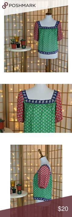 """ANNA SUI Silk Crepe Cropped Top Medium Good pre-owned condition, no noted flaws.   Approximate measurements: ~22"""" from shoulder to hem, ~16"""" bust laying flat, ~18"""" waist laying flat  Silk cropped/shorter top with a unique pattern and color scheme. Sheer silk crepe fabric. See measurements for length. Anna Sui Tops Blouses"""