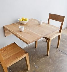 fold up table for use as dining table use comfy chairs to double as living room