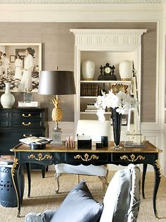 "Greige, black, cream, and gold are painfully chic, but the terrific millwork (wainscotting, built-in with pediment, and detailed mouldings) is what gives this room its gravitas.     Above comment from ""The Foo Dog Ate My Homework"". This beautiful room feels  more ""curated"" than ""gravitas"" to me. Either way, this office is fabulous.  Ahhh... Mary McDonald"