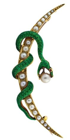 A Victorian Enamel Snake Brooch with Seed Pearl. Finely detailed Green Enamel Snake twisted around a seed pearl encrusted 15 Karat yellow gold Crescent Moon. #Victorian #brooch