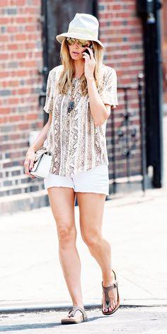 Heidi Klum wearing the Michael Kors Sloan Flap bag. New York City, June 2013
