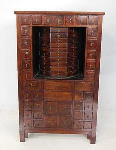 So want this for my kitchen filled with wild & exotic herbs & spices... Chinese Huanghuali & rosewood medicine chest w/Revolving center 101 drawers....
