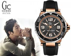Guess Collection by Guess is a line of high-end luxury goods that signify that their owner has class and taste. Buy this Guess Collection men's watch with its black and gold two-tone finish and show the world that you have arrived.