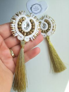 White and gold soutache earrings with gold tassels in a shape of shiny sun