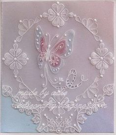 Hello everyone, the butterfly was stamped with VersaMagic Cloud white ink and allowed to dry completely before I embossed it from the back ...