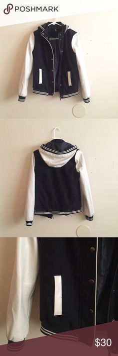 Navy Blue Varsity Jacket Very cute navy blue and cream varsity jacket with a hood! Warm and comfortable. Sleeves are made of faux leather. Pockets on the front. This is a Small but runs a little big. Only worn twice so in great condition! Jackets & Coats