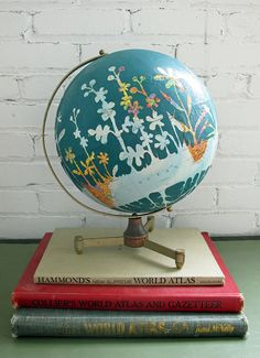 Interesting idea for re-using an outdated globe. Earth Laughs In Flowers/ Hand Painted Vintage Globe by amyriceart
