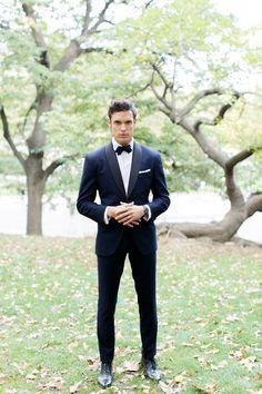 Navy tux groom and groomsmen, navy suit groom, groomsmen attire black, bow tie Smoking Azul, Navy Tuxedos, Navy Suits, Black Suspenders, Groomsmen Suspenders, Black Bow Tie, Blue Suit Black Shoes, Black Tie Suit, Black Tie Tuxedo