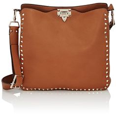 Valentino Rockstud Medium Messenger ($2,545) ❤ liked on Polyvore featuring bags, messenger bags, nude, genuine leather messenger bag, courier bag, leather strap bag, logo bags and nude bag
