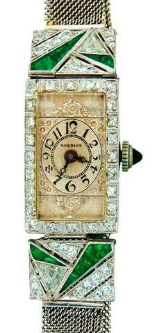 Robbins Lady's Platinum, Diamond and Emerald Art Deco Wristwatch. Elegant Art Deco lady's platinum, diamond and emerald wristwatch. Manual-wind movement, Swiss made, signed Robbins.