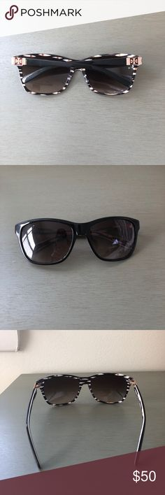 """Tory Burch Black Sunglasses Tory Burch Sunglasses in good used condition. Super simple and stylish black front frame. Pop of color and design on the back of frame and arms. Tory Burch logo on both arms. Lens show minimal wear. One of the arms is a bit """"looser"""" than the other due to screw repair. Tory Burch Accessories Sunglasses"""