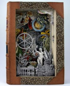 Book carving art - Alexander Korzer Robinson creates his book art by cutting into pages, exposing some of the illustrations while removing others.