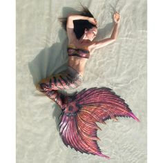 Realistic silicone mermaid tails made for swimming made by Mertailor ($2,730) ❤ liked on Polyvore featuring swimwear, dolphin swim wear, swim wear, swim swimwear and dolphin swimwear