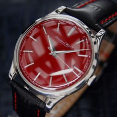 MENS SWISS VINTAGE IWC STAINLESS STEEL DRESS WATCH IN RED, c.1960s