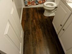 stick and peel vinyl plank flooring. available at lowes. sticks to