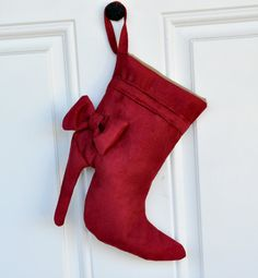 "I saw this and thought about recycling my own boots one day. Redecorate with your own flare and ""voila! Christmas stocking!"""
