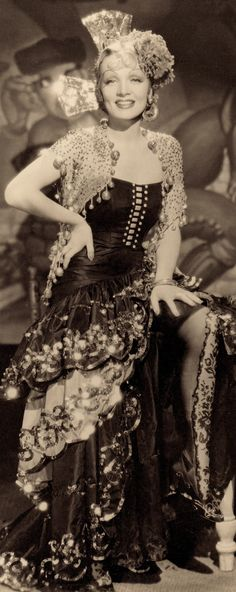 DETAIL : MARLENE DIETRICH as Concha Perez in an ornate Spanish mantilla wearing a gown by TRAVIS BANTON in THE DEVIL IS A WOMAN (1935) Paramount. Directed by Josef Von Sterberg.