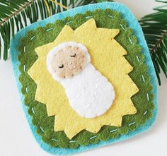 With the Sweet Little Jesus Felt Ornament tutorial you can make homemade Christmas ornaments with meaning.