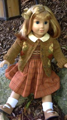 """Cyria from Dancing with Needles on Etsy  created this very special """"Lucy's Lamppost Dress and Sweater"""" featured in """"The Chronicles of Narnia"""". The hand smocked dress and the extraordinary hand knit sweater are an absolute joy to have in my AG collection!  Just beautiful."""