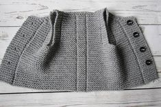 This baby vest is made from of 49% wool, 51% acrylic yarn. It features four buttons for closure The waistcoat is warm, cosily soft and comfortably lightweight. Pictured color: gray Please select desired color and size. Made to order. The baby vest will be ready to ship within 3-4 days