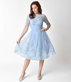 A perennial of grace and beauty, the gorgeous Emmie-Rose dress from Chi Chi London is an etherial dream for a vintage maven! Cut in a beautiful 1950s style silhouette, this lovely frock exudes wonder with a dainty light cornflower blue mesh overlay, embel