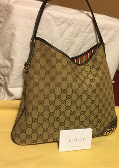 Gucci pre-owned and looks to be never used. Very spotless inside and the outside is in perfect condition. A little hard to see from photos but the leather piece in the corner with the Gucci logo gives