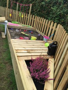 Homemade Sand pit, planting and play area!