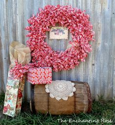 This stunning master piece is a homemade wreath created out of wrapping paper. Great for the holidays to hang up in your home, or to gift as a present. Customize your own gift wrap on Shutterfly
