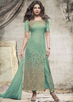 Look #trendy and #graceful in this #green #resham embroidered, sequinned front slit #suit.