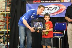 Driver of the No. 2 Miller Lite Dodge Brad Keselowski attended our 2012 RCCA Member Appreciation Party and helped us hand out door prizes and autographed lots of die-cast!