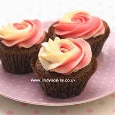 Google Image Result for http://www.lindyscakes.co.uk/Blog/wp-content/uploads/2010/05/CupcakeBook-ButtercreamRoses.jpg