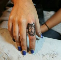 Wolf Finger Tattoo http://tattoos-ideas.net/wolf-finger-tattoo/ Finger Tattoos, Minimal Tattoos