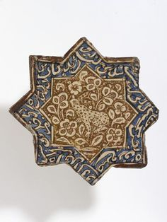 Star-shaped tile, fritware, painted in blue and metallic lustre with a seated hare and inscriptions, Iran (probably Kashan),. Islamic Patterns, Tile Patterns, Ceramic Pottery, Pottery Art, Middle Eastern Art, Arabesque Pattern, Antique Tiles, Metallic Luster, Iranian Art