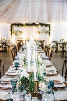 An Intertwined Event: Boho Chic Wedding at Calamigos Ranch Tablescape, White wood table, Blue goblets, Candles, Wedding Decor, Found rentals