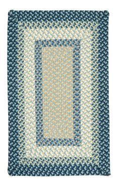 Add some color to your space with the vibrant sea tones of this fade resistant Montego Bay Blue braided indoor-outdoor rug!