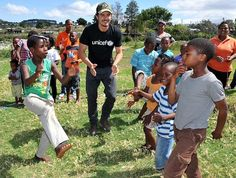 Photo of the Week: Orlando Bloom playing with children in the @UNICEF-supported Isibindi programme near Cape Town, South Africa as @UNICEF's Goodwill Ambassador. He spoke with them about the importance of having safe areas to play.