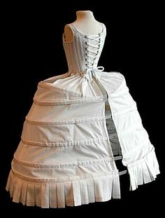 18th century. The hoops were also made of linen and stiffened with whalebone or cane. They shaped the petticoat of the gown to the appropriate silhouette. At various times in the 18th century this profile varied from round, to square and flat, to fan-shaped.