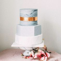 Not a big fan of floral and prefer something simple and modern for your wedding cake? Then this one inspo might be for you! We are truly mesmerized by this delicacy from @tortikannuchka for its prettiness! Composed of round and hexagonal layer, we specifically adore the marble pattern that sets a contemporary and artsy nuance. Extra loving the gold line that surely becomes a nice addition to the while design! What do you think about thisbcake? Leave some comments and show some love! Cake…