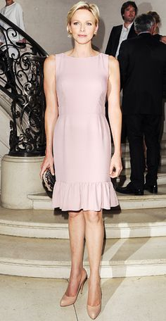 July 2, 2012Princess Charlene of Monaco flew up from her Mediterranean principality to witness Raf Simonss decadent Christian Dior debut. The royal wore a pale pink shift and styled her trademark blond crop in soft natural look for the occasion.