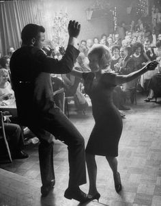 Chubby Checker twistin' with a fan.